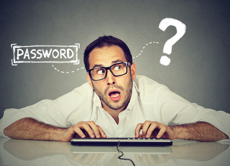 Photo pour Man typing on the keyboard trying to log into his computer forgot password   - image libre de droit