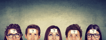Photo pour Multiethnic group of thinking people with question mark looking up - image libre de droit