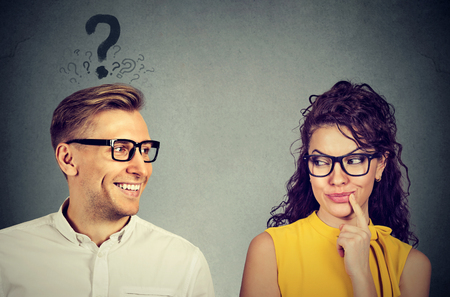 Photo for Does she like me? handsome man with question mark looking at an attractive girl flirting with him. Human emotions face expression perception - Royalty Free Image
