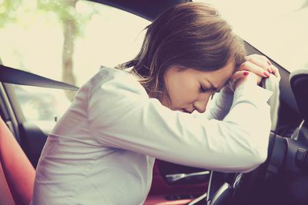 Photo pour Stressed woman driver sitting inside her car - image libre de droit