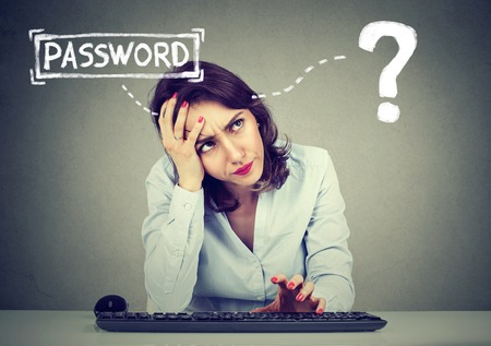 Photo pour Desperate young woman trying to log into her computer forgot password - image libre de droit