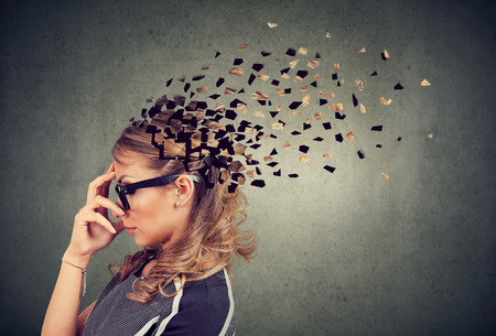 Photo pour Memory loss due to dementia or brain damage. Side profile of a woman losing parts of head as symbol of decreased mind function. - image libre de droit
