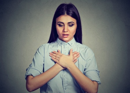 Photo pour Young woman with asthma attack or respiratory problem isolated on gray background - image libre de droit