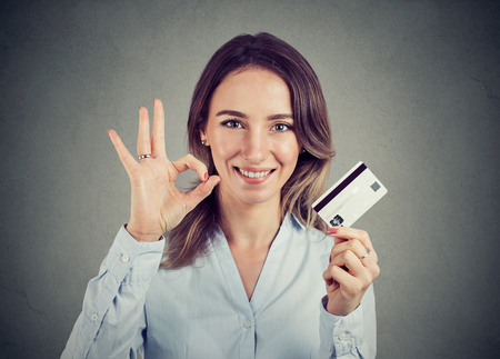 Photo for happy young business woman with credit card giving ok hand sign gesture - Royalty Free Image