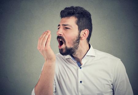 Photo pour Beard man doing a hand breath test - image libre de droit