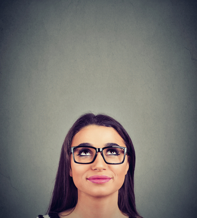Photo for pretty young woman in glasses looking up - Royalty Free Image
