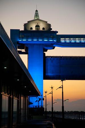 Numazu port facility lighted up in blue, sunset