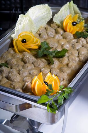 delicious hot main dish with meat balls in cream sauce
