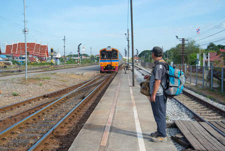 AYUTTHAYA, THAILAND - JANUARY 02, 2017: The man expects arrival of the passenger train on the platform of the station Ayutthaya