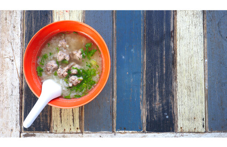 Gruel pork soup resort breakfast retro wood desk blue color tone trip at Koa Yai Saraburi Province Thailand Asi