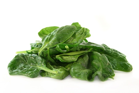a handful of spinach on a white background
