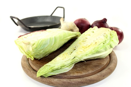 a sliced sweetheart cabbage on a wooden board