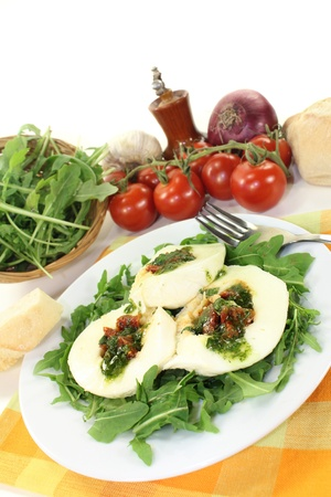 stuffed mozzarella on a rocket in front of white background