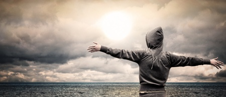 Open ocean with a girl raising her arms