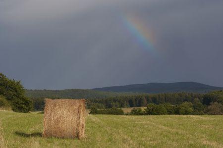 dark sky with rainbow