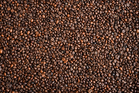 Mixture of different kinds of coffee beans. Coffee Background