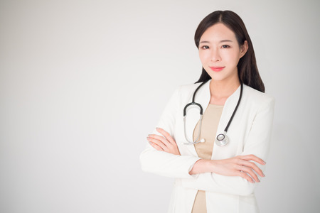 Foto de Beautiful asian woman female doctor isolated on white background, medical, doctor, clinical, hospital concept. Woman or female doctor is lacked in some country. Doctor is the necessary career. - Imagen libre de derechos