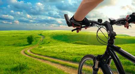 Foto de Man with bicycle riding country road - Imagen libre de derechos