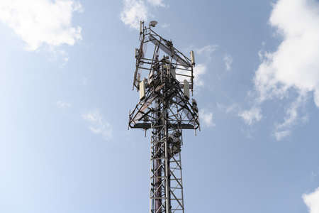 Photo for Telecommunication network repeaters, base transceiver station. Tower wireless communication antenna transmitter and repeater. Telecommunication tower with antennas. Cell phone telecommunication tower. - Royalty Free Image