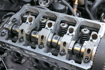 Repairing of modern diesel engine closeup of camshaft and valves
