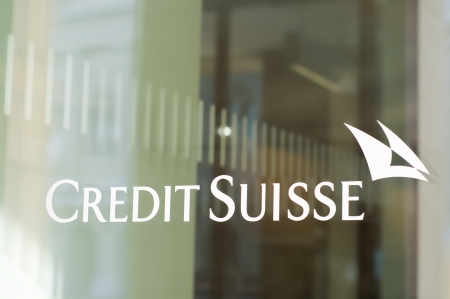 Bern, Switzerland - February 18, 2012: The Credit Suisse logo in a window of a branch. CS is a globally active financial services company offering investment banking, asset and wealth management.