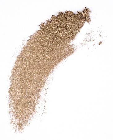 golden eyeshadow isolated on white