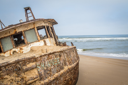 Stranded boat at the coast of the Namibian Desert, Namibia.