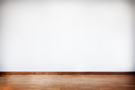 horizontal composition of empty room with white wall and wooden floor