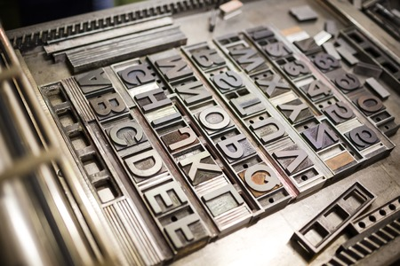 Old typography printing machine with font characters for craftman typography
