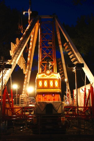 illuminated Construction of carousel in evening park