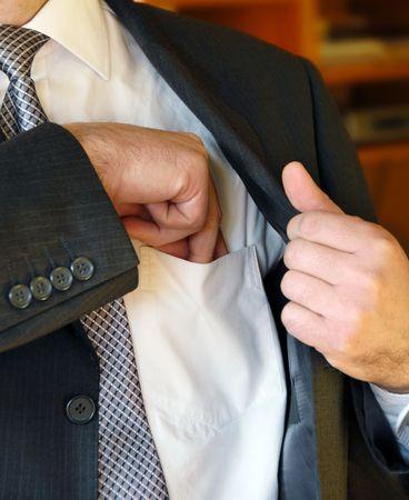 Businessman hand  in inner jacket pocket