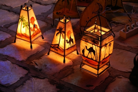 three lamps on street by souvenir shop in Tunisia