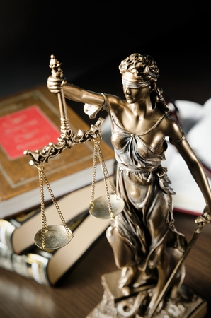 Photo pour Law concept with Themis and books in background. Composition in court library - image libre de droit