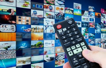 Foto de Television broadcast multimedia abstract composition with remote control - Imagen libre de derechos