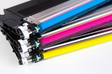 Toner cartridge set for laser printer. Computer supplies on white background.
