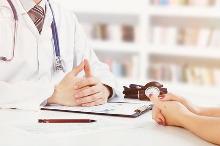 Doctor and patient medical consultation. doctor patient health care office desk stethoscope medical concept