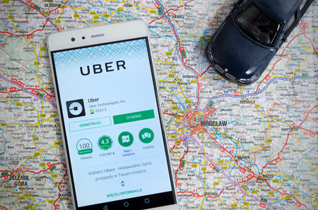 WROCLAW, POLAND - JULY 20, 2017: Uber sharing economy service is frequently used form of urban transport in Wroclaw