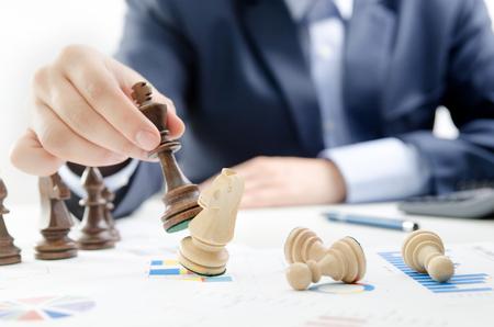 Photo pour Chess financial business strategy concept. Team leader holding chess piece. - image libre de droit