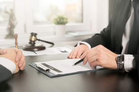 Photo pour Male lawyer working with contract papers. Lawyer or judge consult, meeting with client. Law and Legal services concept - image libre de droit
