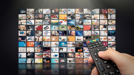 Foto de Television streaming video concept. Media TV video on demand technology. Video service with internet streaming multimedia shows, series. Digital collage wall of screen abstract composition - Imagen libre de derechos