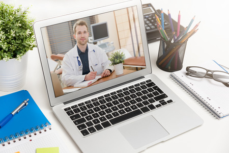 Photo pour Doctor with a stethoscope on the computer laptop screen. Telemedicine or telehealth concept. - image libre de droit