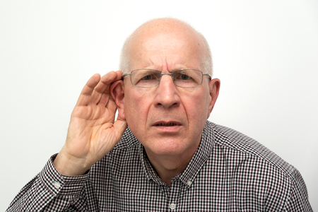 Photo pour Senior suffering from deafness. Man asks to repeat the question - image libre de droit
