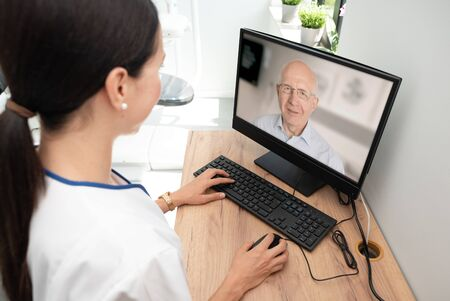 Photo pour Doctor and senior man patient medical consultation, telehealth, telemedicine, remote health care concept. - image libre de droit