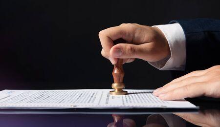 Photo pour Lawyer, notary, attorney, legal concept. Man stamps the document - image libre de droit