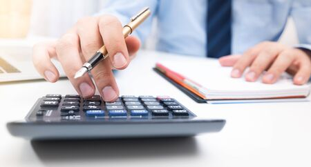 Photo pour Accountant calculate tax information or business data. Businessman working in office - image libre de droit