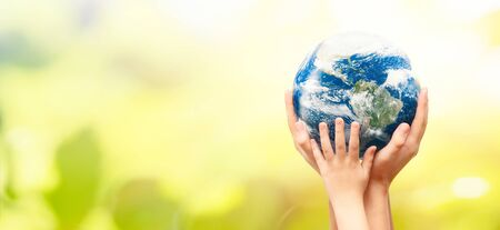 Photo pour Earth globe in family hands.  environment day concept. Elements of this image furnished by - image libre de droit