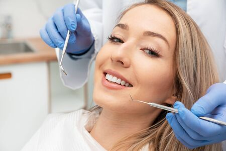 Photo pour Woman having teeth examined at dentists. Teeth whitening, dental care concept - image libre de droit