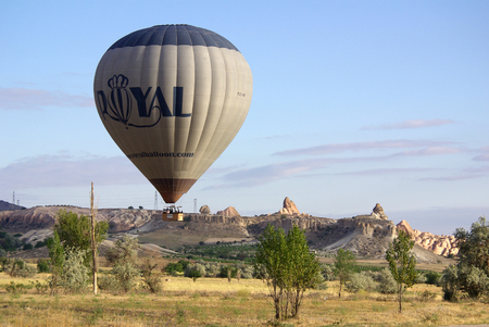 GOREME, TURKEY - June, 2014: Hot air balloon fly over Cappadocia in Goreme