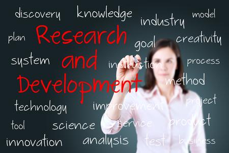 Photo pour Young business woman writing research and development concept - image libre de droit