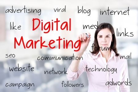 Business woman writing digital marketing concept. Office background.
